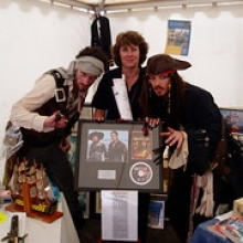 "Chairman encounters pirates whilst fundraising<br /><span style=""font-size:0.8em;"">Penny Phillips has a run in with some pirates at the Queens Wharf, Falmouth – 2008.  Fundraising at Tall Ships.</span> • <a style=""font-size:0.8em;"" href=""http://www.flickr.com/photos/110395756@N08/11163659704/"" target=""_blank"">View on Flickr</a>"